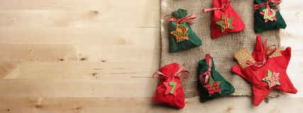 traditional advent calendar with small fabric bags for individual filling lying on a wide wooden surface & x28;birch& x29; stock photography