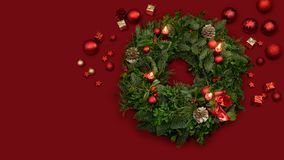 Traditional advent wreath of fir twigs mistletoes and berries with candlelight and decoration. Traditional advent wreath of green fir twigs and mistletoes with stock image
