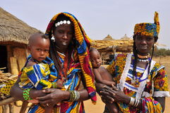 Traditional african dresses, women with children. Colourful traditional african dresses, women with children in african village, festival, Niger royalty free stock image