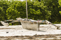Traditional african fishingboat on beach. Traditional african outrigged wooden fishingboat on the beach. Dar es Salaam. Tanzania, Africa royalty free stock images