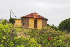 Traditional African hut. Mud hut with zinc iron roof in rural area Royalty Free Stock Photo