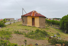 Traditional African hut. Mud hut with zinc iron roof in rural area Stock Images