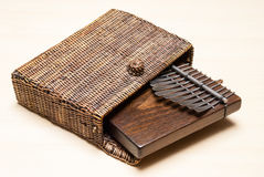 Traditional African instrument kalimba or thumb piano in a wicker case Stock Image