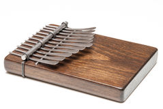 Traditional African instrument kalimba or thumb piano. A traditional African wooden instrument kalimba or thumb piano Royalty Free Stock Image