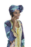 Traditional african woman talking with smart phone Stock Photos