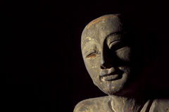Traditional Aged Carving of a Buddhist Monk. Buddhist monk carving in the form of an aged relic, Face showing serene contentment Stock Photography