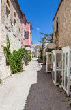 Traditional alley in Alacati, Izmir province, Turkey. Alacati, well known for its architecture, vineyards and windmills is a popular summer tourist destination Royalty Free Stock Photography