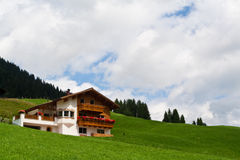 Traditional alpine chalet. Summer time Stock Photos