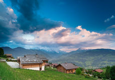 Traditional alpine country houses in France. Traditional alpine country houses in French Alps under sunset clouds. Haute-Savoie region of France Stock Images