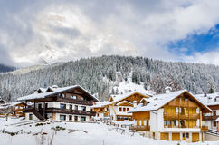 Traditional Alpine Houses Covered in Snow Stock Photo