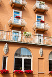 Traditional alpine houses with flowers on balcony, Cortina d'Amp Stock Images