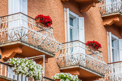 Traditional alpine houses with flowers on balcony, Cortina d'Amp Royalty Free Stock Photo