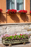 Traditional alpine houses with flowers on balcony, Cortina d'Amp Royalty Free Stock Photography
