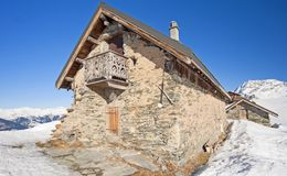 Traditional alpine hut on a mountain Royalty Free Stock Photography