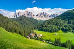 Traditional alpine St Johann church in Val di Funes valley, Santa Maddalena touristic village, Dolomites, Italy. Royalty Free Stock Photo