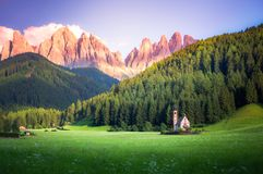 Traditional alpine St Johann church in Val di Funes valley, Santa Maddalena touristic village, Dolomites, Italy. Royalty Free Stock Image