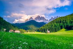 Traditional alpine St Johann church in Val di Funes valley, Santa Maddalena touristic village, Dolomites, Italy. Royalty Free Stock Photography