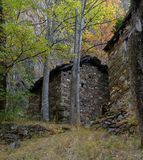 Mountain stone architecture in the Italian Alps. Autumn colors Stock Image