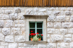 Traditional alpine stone window. Royalty Free Stock Photography