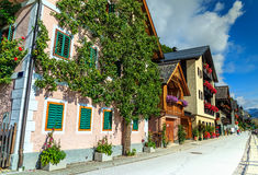 Traditional alpine village street with colorful flowers,Austria,Europe Stock Photos