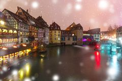 Night Petite France in Strasbourg, Alsace. Traditional Alsatian half-timbered houses and canal in Petite France at snowy christmas night, Strasbourg, Alsace Stock Images