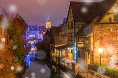 Christmas Little Venice in Colmar, Alsace, France. Traditional Alsatian half-timbered houses, church and river Lauch in Petite Venise or little Venice, old town Royalty Free Stock Photo