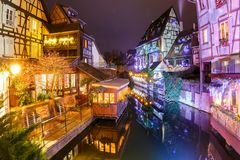 Christmas Little Venice in Colmar, Alsace, France. Traditional Alsatian half-timbered houses in Petite Venise or little Venice, old town of Colmar, decorated and Stock Photos