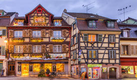 Traditional Alsatian Houses in Winter. COlmar,France- December 6, 2013: Image of traditional Alsatian half-timbered houses decorated in winter holidays in Colmar Royalty Free Stock Images