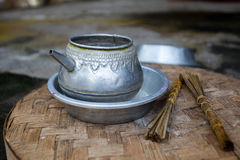 Traditional aluminum kettle for ceremonies in the temple. Traditional old aluminum kettle and incense for ceremonies in the temple. Indonesia Bali Stock Images