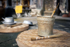 Traditional aluminum kettle for ceremonies in the temple. Traditional old aluminum kettle and incense for ceremonies in the temple. Indonesia Bali Royalty Free Stock Photo