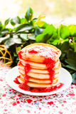 Traditional american breakfast with homemade pancakes and strawberry sauce Royalty Free Stock Photos