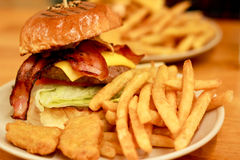 Traditional american burger, Freshly french fries and chicken nuggets Royalty Free Stock Photography