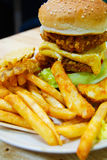 Traditional american burger, freshly french fries with omelette egg Stock Photo