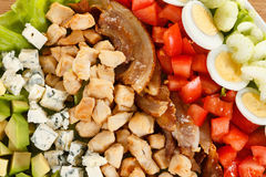 Traditional American Cobb Salad. Colorful entree salad with bacon, chicken, eggs and tomatoes. Closeup as background royalty free stock photo