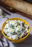 Traditional American potato salad with egg and mayonnaise, served with bread. Rustic style. Selective focus stock photos