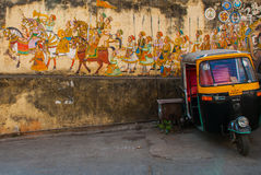 Traditional ancient stile indian wall painting on the old plastered wall in Udaipur, India Royalty Free Stock Photo