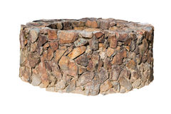 Traditional Ancient stone well on white. Royalty Free Stock Photo