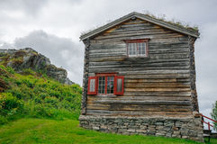 Traditional ancient wooden norwegian loghouse Stock Photo