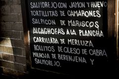 Traditional Andalusian food, slate written typical dishes Meditarranea cuisine Stock Photography