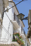 Traditional Andalusian streets with flowers and white houses in Stock Images
