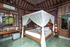 Traditional and Antique Javanese Style Bedroom villa in Bali Stock Photo