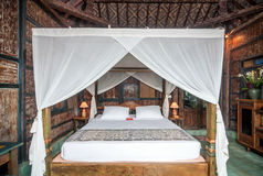 Traditional and Antique Javanese Style Bedroom villa in Bali Royalty Free Stock Photos