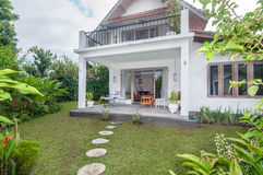 Traditional and antique Villa design with clean garden Royalty Free Stock Image