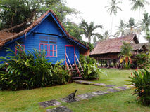 Traditional antique village houses, Malaysia. A photograph showing the beautiful rustic style architecture of two old traditional ethnic Malay stilt houses well Royalty Free Stock Photo