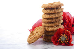 Traditional ANZAC Biscuits with Poppies Royalty Free Stock Image