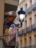 Traditional Apartment Buildings, Valencia. Traditional attached apartment buildings in Valencias Old Town, most with small balconies Stock Photo