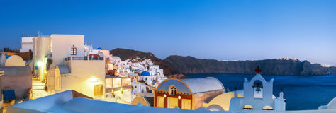 Traditional apartments and bell towers in Oia, Santorini, Greece Royalty Free Stock Photography