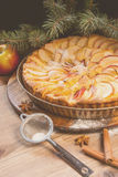Traditional apple pie and Christmas tree branches, toned Stock Photo