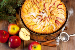 Traditional apple pie and Christmas tree branches Stock Photos