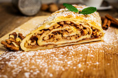 Traditional apple strudel. Or pie with walnuts and whipped cream Royalty Free Stock Images